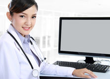 Doctor woman sitting on her office Stock Images