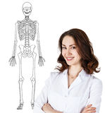 Doctor woman standing near drawing human skeleton Royalty Free Stock Photos