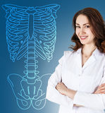 Doctor woman standing near drawing human skeleton Royalty Free Stock Image