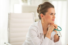 Doctor woman with stethoscope in office Stock Images