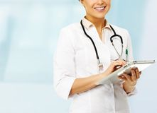Doctor woman taking notes Stock Photos