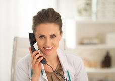 Doctor woman talking phone Stock Images