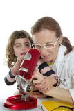 Doctor woman teacher and pupil microscope Stock Photos