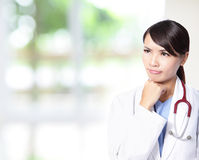 Doctor woman think with stethoscope Stock Photo