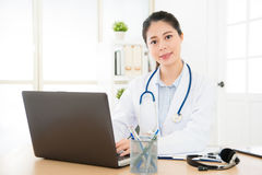 Doctor woman typing with laptop system Royalty Free Stock Photos