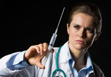 Doctor woman using syringe Royalty Free Stock Images