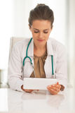 Doctor woman using tablet pc in office Royalty Free Stock Photo