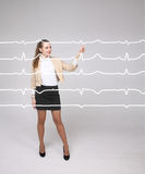 Doctor woman working with cardiogram lines. Young doctor woman working with cardiogram. Electrocardiogram lines in air Royalty Free Stock Images