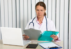 Doctor woman working in clinic. Stock Photos