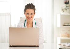 Doctor woman working on laptop in office Stock Photography