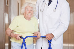 Doctor and Woman with Zimmerframe Royalty Free Stock Images