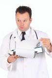 Doctor wonder 3. Young doctor write his notices on the notice board and and asking himself did he skipped something in examination Stock Images