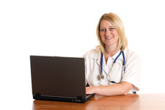 Doctor at work. Medical doctor sits on desk and works with computer Royalty Free Stock Photos