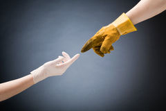 Doctor and Worker Hands Touching stock image