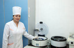 Doctor working with  blood centrifuge Stock Image