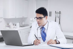 Doctor working in the clinic with laptop Royalty Free Stock Photo