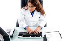 Doctor working on computer stock images