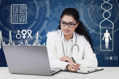Doctor working on desk with futuristic background Royalty Free Stock Photos