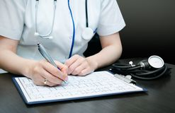 Doctor working at desk Royalty Free Stock Photo