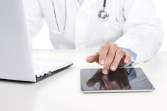 Doctor working on a digital tablet Stock Photos