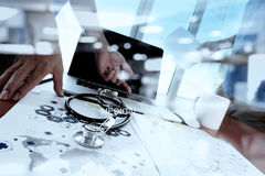 Doctor working with digital tablet and laptop computer Royalty Free Stock Images