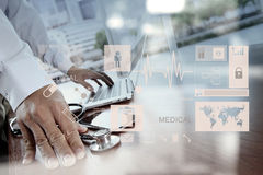 Doctor working with digital tablet and laptop computer Stock Photos