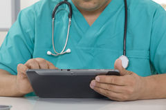 Doctor working on a digital tablet Royalty Free Stock Photography