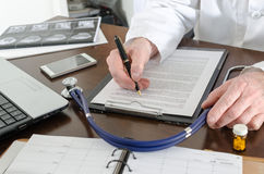 Doctor working on a document Royalty Free Stock Image