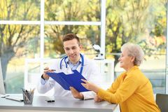 Doctor working with elderly patient royalty free stock photos