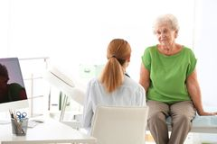 Doctor working with elderly patient royalty free stock images