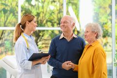 Doctor working with elderly patients. In hospital royalty free stock images