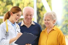 Doctor working with elderly patients. In hospital stock photography