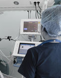Doctor working with electronic equipment in the ICU Stock Image