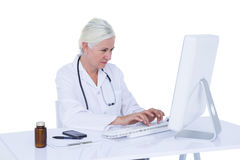 Doctor working on her computer Stock Photography