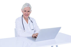 Doctor working on her laptop Stock Photo