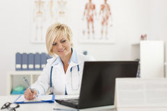 Doctor working at her office Royalty Free Stock Photo