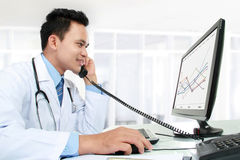 Doctor working with his computer Stock Image