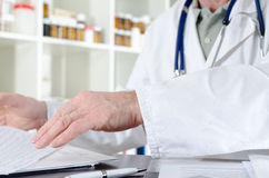 Doctor working at his desk Royalty Free Stock Image