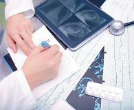Doctor working at his desk Stock Photos