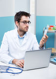 Doctor working at his desk Stock Image
