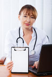 Doctor working in hospital Stock Image