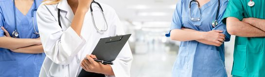Doctor working in hospital with other doctors. Healthcare people group. Professional doctor working in hospital office or clinic with other doctors, nurse and stock image