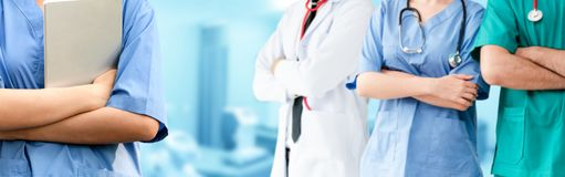 Doctor working in hospital with other doctors. Healthcare people group. Professional doctor working in hospital office or clinic with other doctors, nurse and stock images