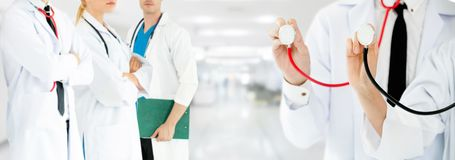 Doctor working in hospital with other doctors. Healthcare people group. Professional doctor working in hospital office or clinic with other doctors, nurse and royalty free stock photo
