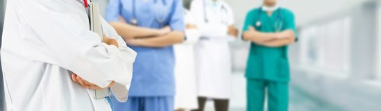 Doctor working in hospital with other doctors. Healthcare people group. Professional doctor working in hospital office or clinic with other doctors, nurse and royalty free stock photos