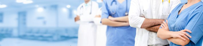 Doctor working in hospital with other doctors. Healthcare people group. Professional doctor working in hospital office or clinic with other doctors, nurse and stock photo