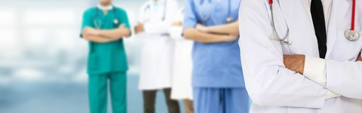 Doctor working in hospital with other doctors. Healthcare people group. Professional doctor working in hospital office or clinic with other doctors, nurse and stock photos