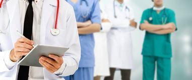 Doctor working in hospital with other doctors