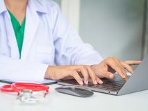 Doctor working with laptop computer in her office. Health care a stock photo