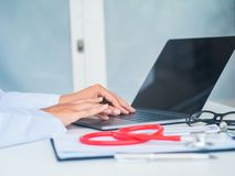 Doctor working with laptop computer in her office. Health care a stock image